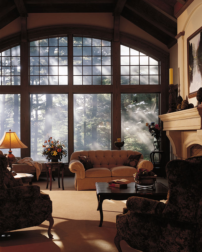 Pella Fixed Windows with Pella Fixed Arch Top Windows with Traditional Square Grilles.
