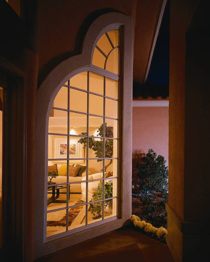 Pella Specialty Window with Circle Top with Traditional Square Grilles.