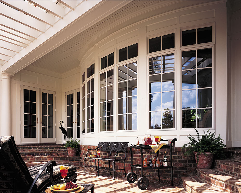 Pella Architect French Doors and Pella Bow Windows with Architect Fixed Casements and Transoms with ILT (True Divided Lite} Traditional Grilles.